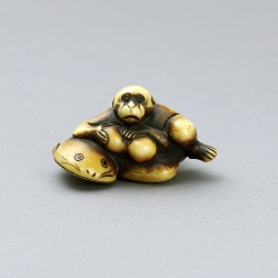 Ivory netsuke of a monkey on namazu